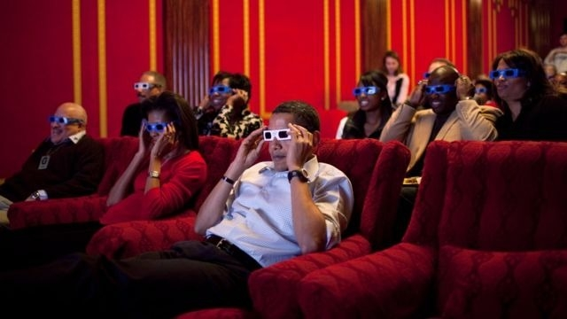 The Obamas wear 3D glasses while watching the Super Bowl in the family theatre of the White House on 2 February 2009