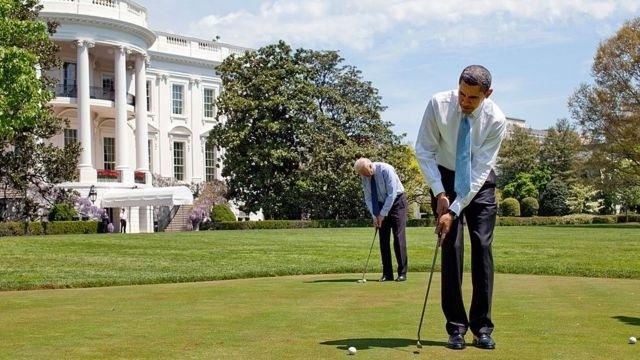 President Barack Obama and Vice-President Joe Biden play golf on the White House putting green on 24 April 2009